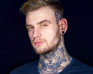 portrait of a man with tattoos